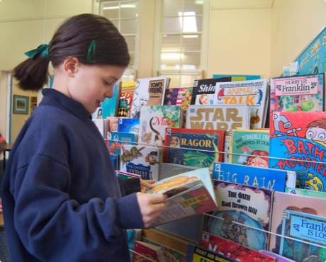 Student choosing a book at school